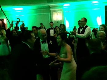 Bride, Groom, Dad singing & dancing